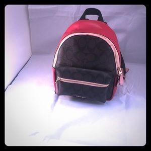 Coach Mini Charlie Backpack In SignatureCanvas